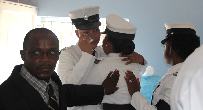 Police Officers Console Each Other At Charles' Funeral. (Iwn Photo)