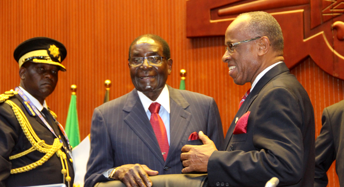 Deputy Prime Minister Of St. Vincent And The Grenadines, Sir Louis Straker, Right, Chats With President Of Zimbabwe, Robert Mugabe At The Acp Summit In Papua New Guinea. (Photo: Acp/Josephine Latu-Sanft)