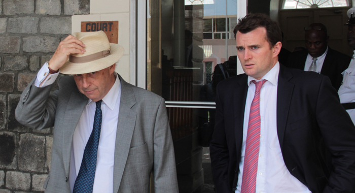 Queen's Counsel Justin Fenwick And A Colleague Leave The Court Building In Kingstown On Wednesday. (Iwn Photo)