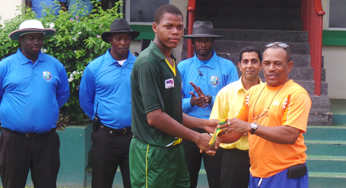 Anil Mathews Collects His Man Of The Match Prize From Samuel Holder, General Secretary Of Svg Cricket Association.