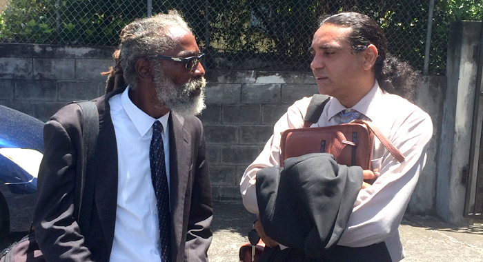 Prosecutor Carl Williams, Left, And Defence Counsel, Ronnie Marks, Chat After Tuesday'S Court Appearance. (Iwn Photo)