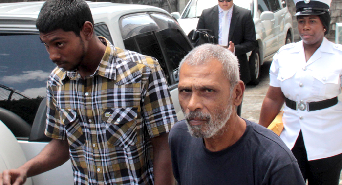 The Two Trinidadians Walk Towards A Police Transportaiton After Exiting The Serious Offences Court In Kingstown. (Iwn Photo)