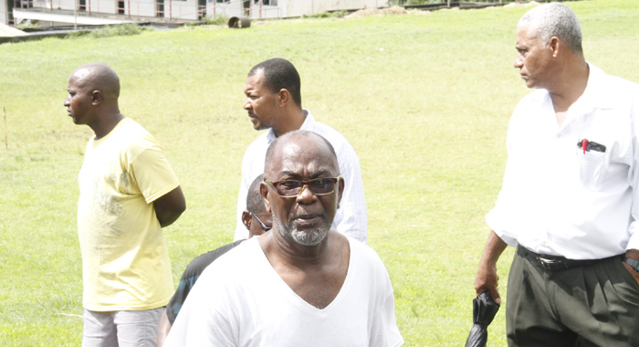 Mp For Central Kingstown, St. Clair Leacock And Other Persons At The Scene In New Montrose. (Iwn Photo)