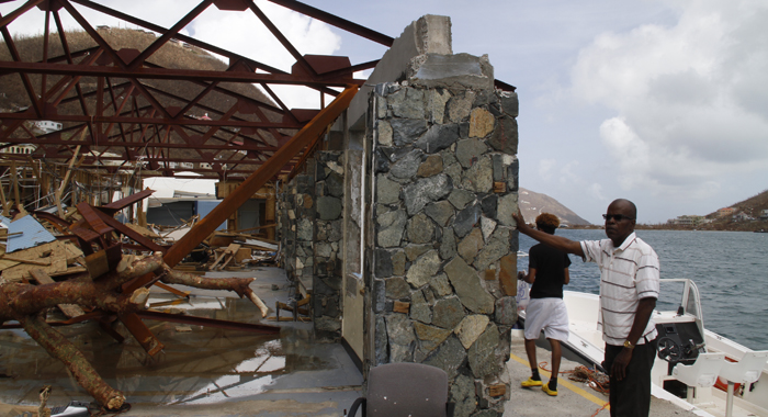 Commissioner Of Customs Aubrey Forbes Surveys The Damage At The Jost Van Dyke Ferry Terminal In West End Tortola. Cmc Photo