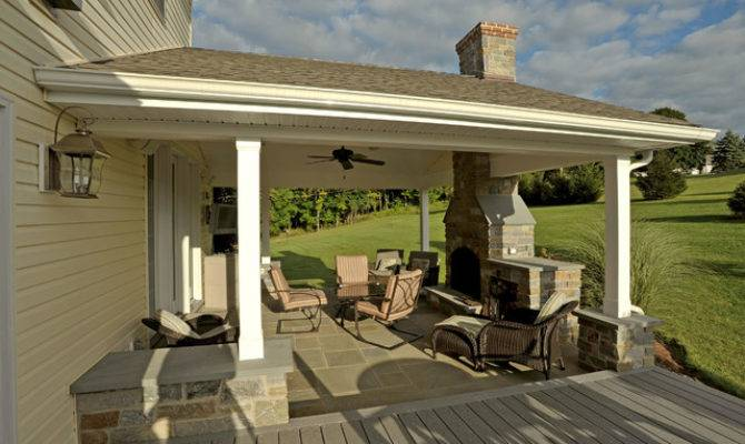 covered porch stone hearth fireplace