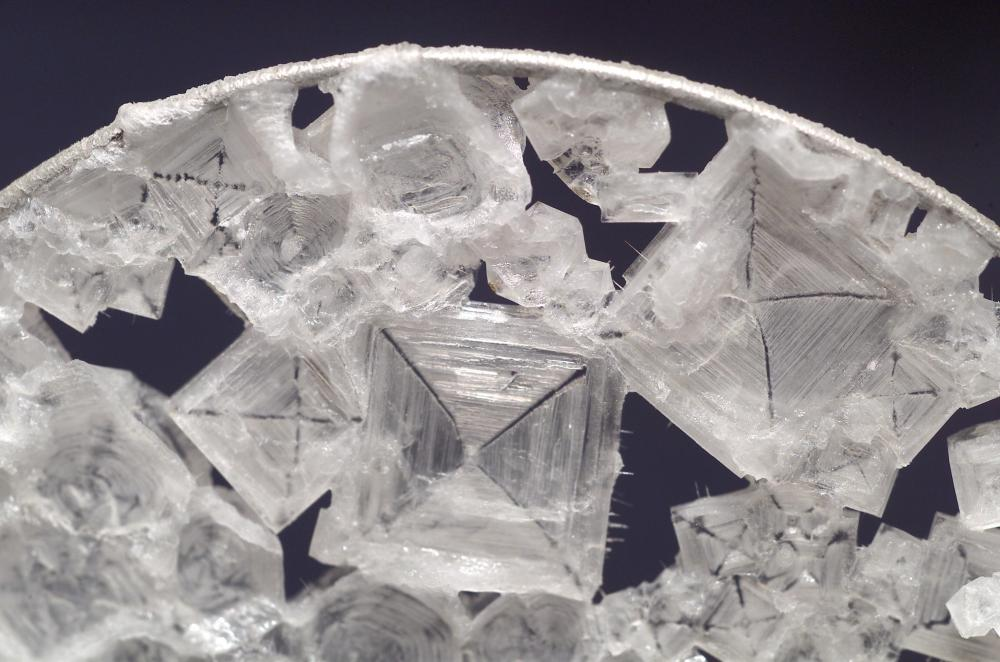 medium resolution of close up view of colorless sodium chloride crystals which have the overall shape of a
