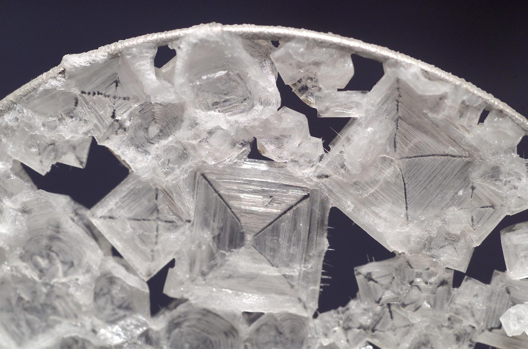 hight resolution of close up view of colorless sodium chloride crystals which have the overall shape of a