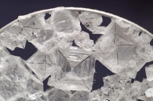 small resolution of close up view of colorless sodium chloride crystals which have the overall shape of a
