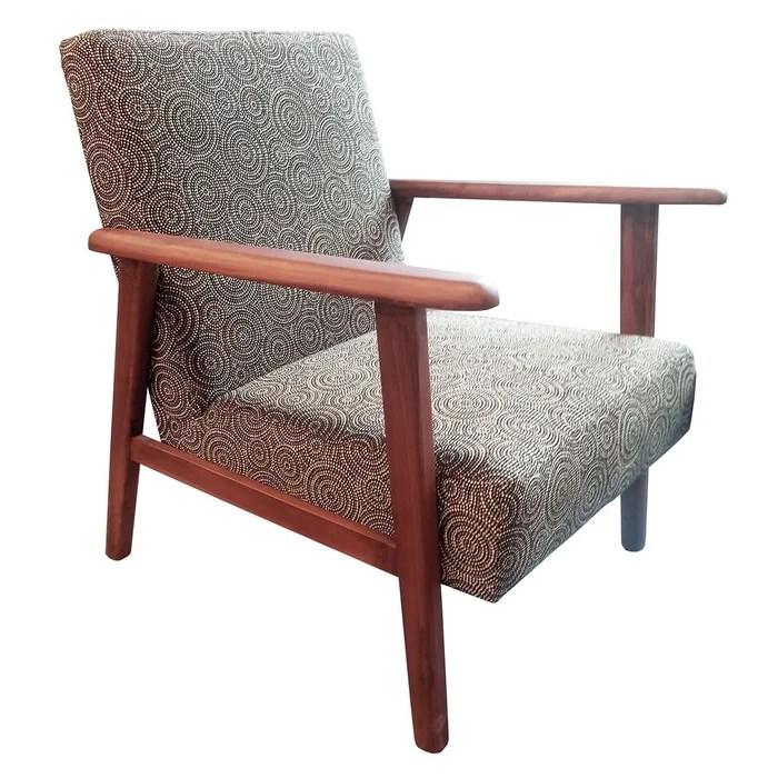 fauteuil en tissu accoudoirs bois motifs exotiques zanzibar