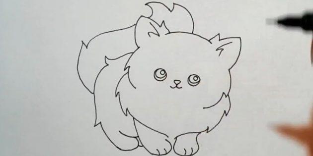 고양이 푹신한 꼬리를주고 귀에 머리카락을 시도하십시오.