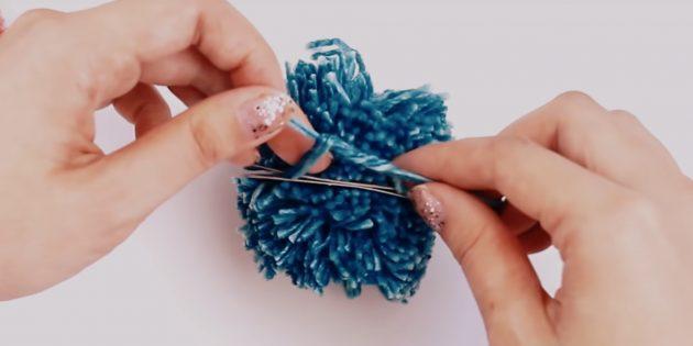Comment faire un pompon: attacher le fil