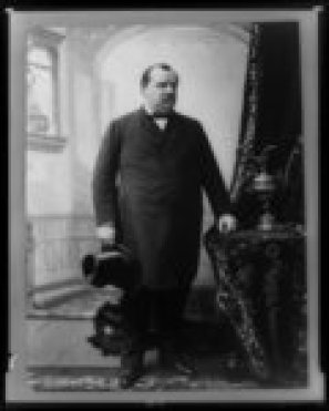 Grover Cleveland, full-length portrait, standing, facing right, holding hat