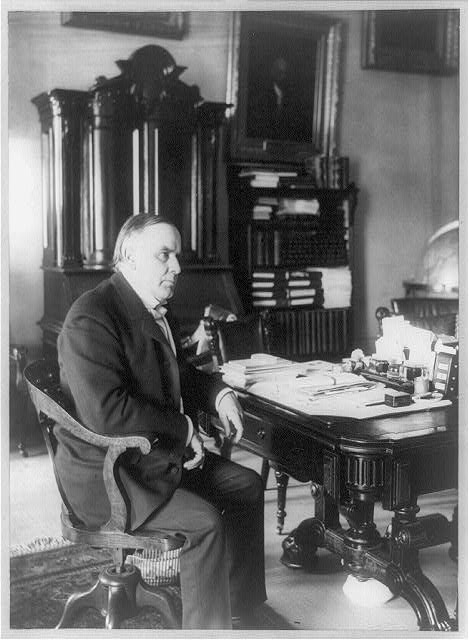 Library of Congress description: William McKinley, full-length portrait, seated at desk, facing right, June 7, 1898. Library of Congress image