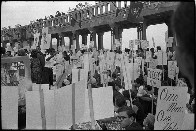 [African American and white Mississippi Freedom Democratic Party supporters demonstrating outside the 1964 Democratic National Convention, Atlantic City, New Jersey; some hold signs with portraits of  slain civil rights workers Andrew Goodman and Michael Schwerner]
