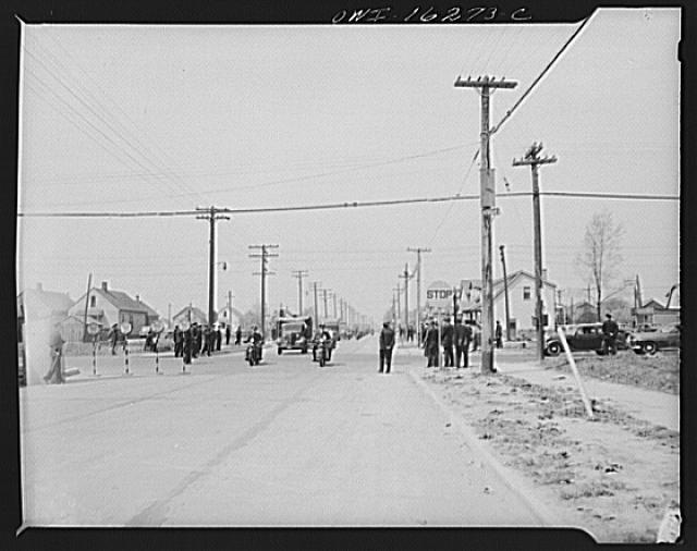 Detroit, Michigan. Riot at the Sojourner Truth homes, a new U.S. federal housing project, caused by white neighbors' attempt to prevent Negro tenants from moving in. Furniture vans under police convoy