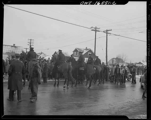 Detroit, Michigan. Riot at the Sojourner Truth homes, a new U.S. federal housing project, caused by white neighbors' attempt to prevent Negro tenants from moving in. Mounted police