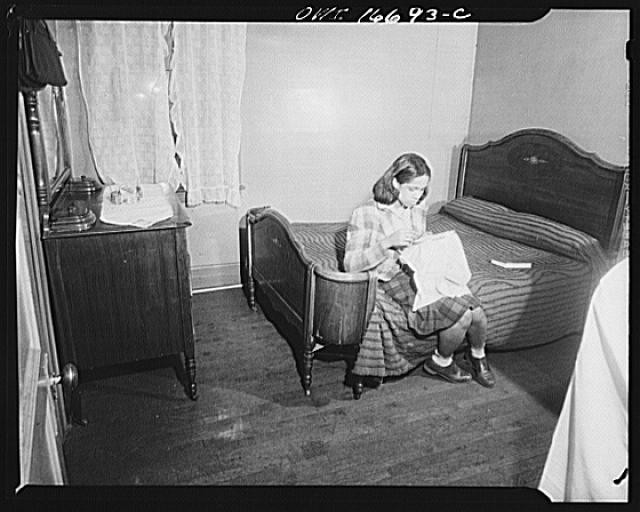Detroit, Michigan. Negro doing embroidery work in her bedroom. These are conditions under which families originally lived before moving to the Sojourner Truth housing project