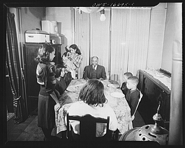 Detroit, Michigan. Negro family at dinner. These are conditions under which families originally lived before moving to the Sojourner Truth housing project