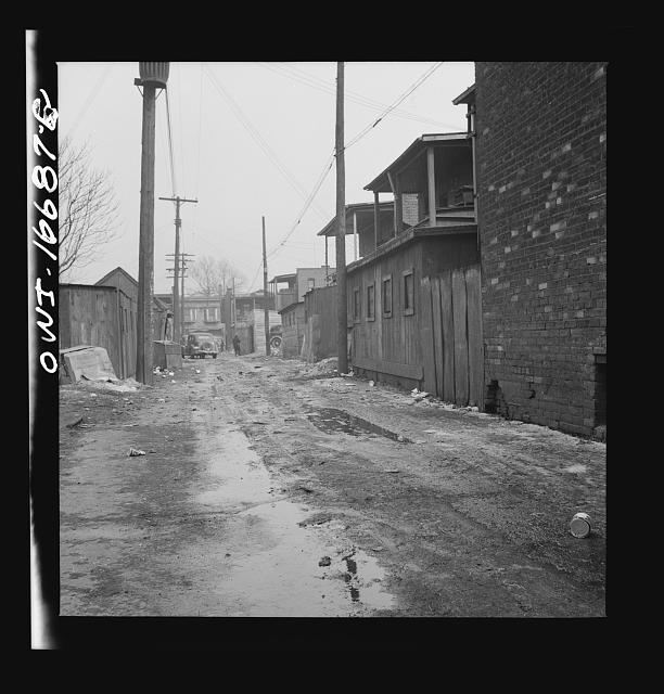 Detroit, Michigan. Alley in a Negro neighborhood. These are conditions under which families originally lived before moving to the Sojourner Truth housing project