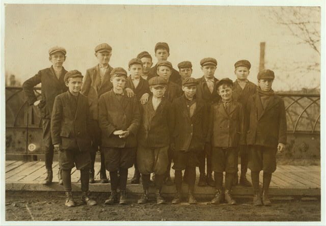 Group working in Ludlow Mills. George Barcome, Stoney Hill, Ludlow. (Front row right hand end). Been band boy for three months in #10 mill. Frank Shefjack (next George) see #2665. Eddie Grimshaw, 40 Stony Hill, (next Frank and in the middle) see #2662. Antony Gourek, (next to Eddie) see #2666. Lemmie Gebo, Indian Leap St., Indian Orchard. (Next to Antony.) Been at work in #4 Mill for four months (is young). Sam Baupre, 145 Main St., (next Lemmie, left hand in front) works in #4 Mill. Stoney Severyn, 25 Wesson St. (One of the smallest boys in the back row.)  Location: Ludlow, Massachusetts.