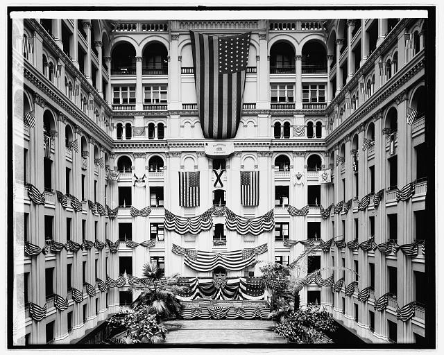 Flags at Post Office building, Pennsylvania Ave., Washington, D.C. on Flag Day, 1913. Now commonly referred to as the Old Post Office Building, this is the lobby of the Trump Hotel, 104 years later. Library of Congress image, from the National Photo Company Collection.