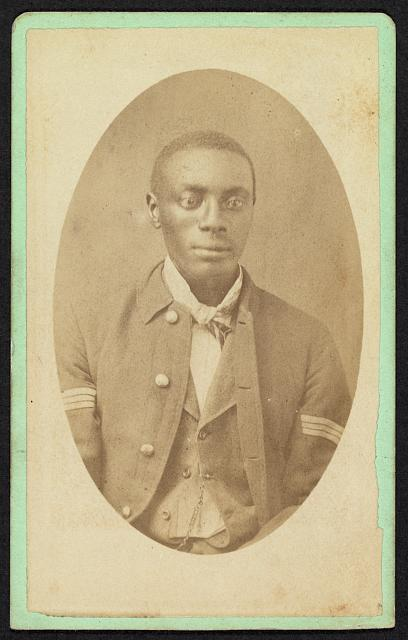 [Half-length portrait of an African American man, possibly a Buffalo soldier]