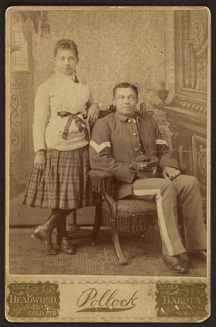 [Infantry sergeant, Buffalo soldier, with young girl]