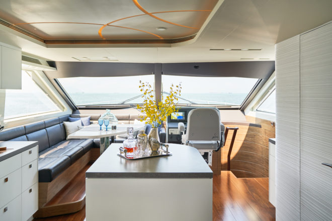 The island counter provides a social hub by the galley and dining table