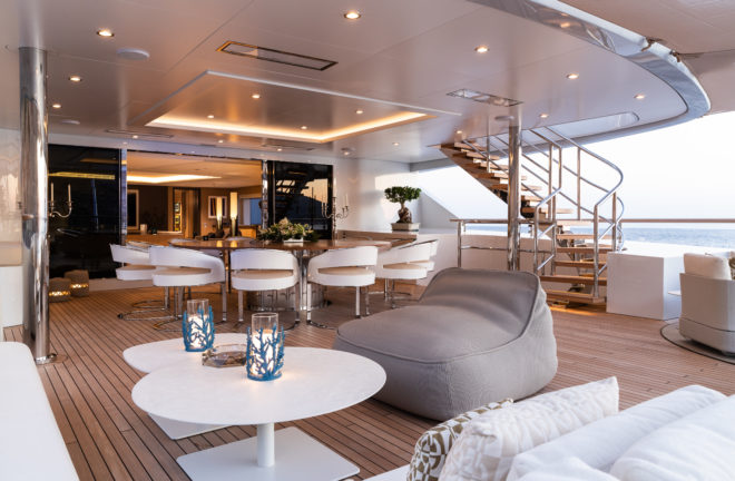 On the upper deck, or owner's deck, the expansive covered aft area has a large, circular dining table for 10 and lots of seating space