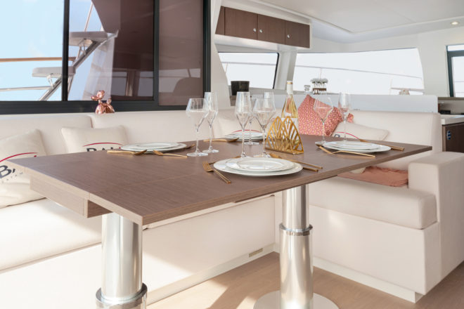 Ahead of the dining table is the galley, ideally placed for serving food on the Bali 4.3 MY