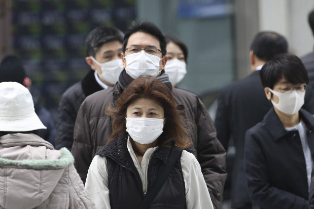Japan issues coronavirus medical guidance as infections rise - The ...