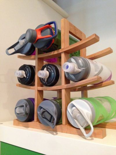 kitchen wine rack water bottle storage inside a cabinet