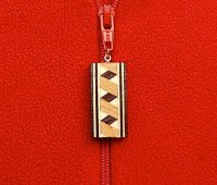 gilleland_inlay_jewelry_zipper_300dpi.jpg