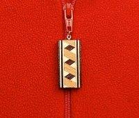 gilleland_inlay_jewelry_zipper_300dpi.jpg