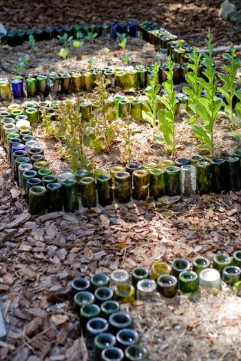 Wine bottles as garden markers make for Jardin glass jars