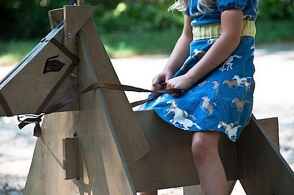 littlegirlwoodenhorse.jpg