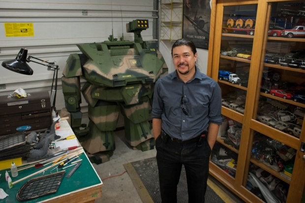 Fon Davis in his workshop, flanked by a case of miniatures and a Gen 1 MORAV.