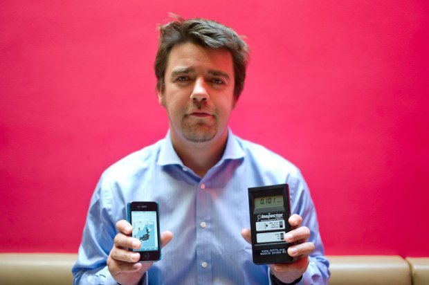 Safecaster  Dave Kell with the Geiger counter and iPhone he used on the very first mobile measurement run, pre-bGeigie.
