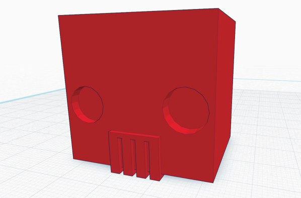 3d rendering of a red square pencil topper with indented circle eyes and a grill-like mouth.