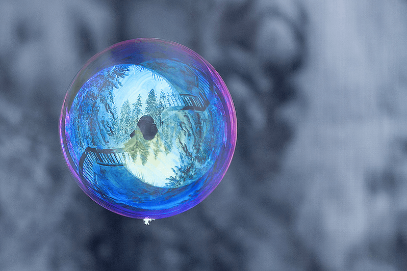 tom falconer bubble in a snowy forest