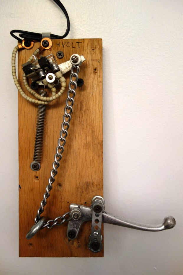 The mercury tilt switch was salvaged from a heavy appliance, and modified into this lever-style door handle. The switch initiated a doorbell on the other end.