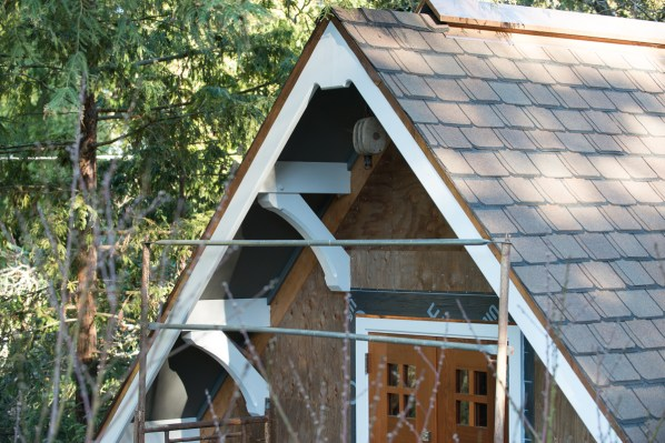 The north gable end of my current detached garage project showing the recycled redwood loading doors and copper ridge vent.