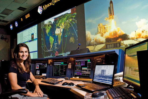 When it's Houston's problem: Pam Martin sits on console in Mission Control at NASA's Johnson Space Center, where she and other flight controllers guide astronauts through routine and emergency maintenance onboard the International Space Station.
