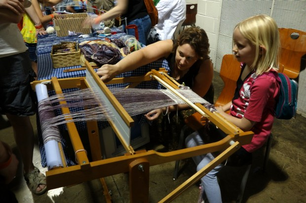 People of all ages were learning about looms.