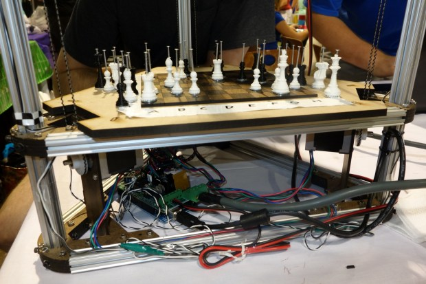 This magnetically-operated chess board was hacked from a DeltaBot 3D printer, Arduino, and pieces printed from the printer itself.