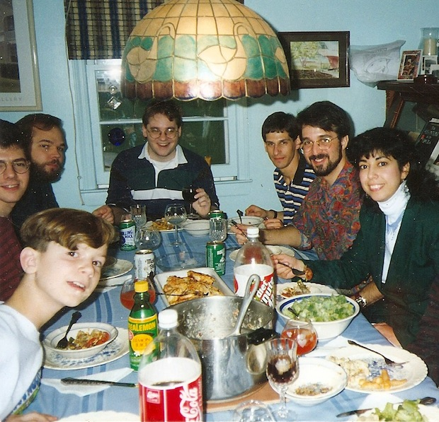 The author as a young man, photo-bombing a bunch of hungry physics geeks.