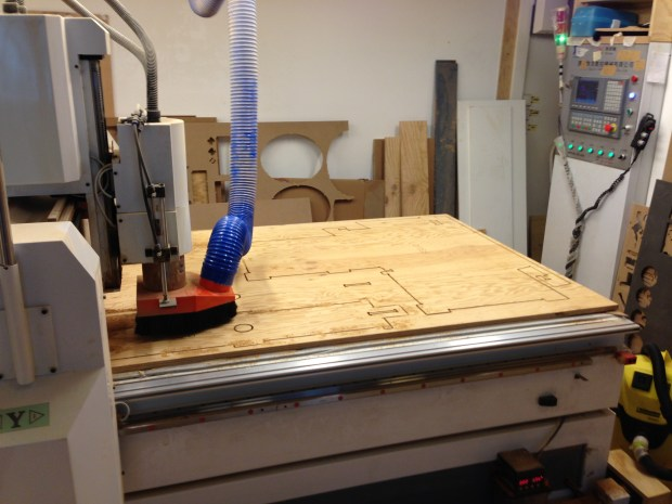 A CNC machine cuts out panels for a wikiihouse.