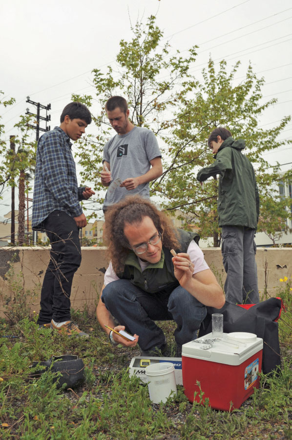 Wildwood teacher Levi Simons and his students use chemical indicator testing kits to map Los Angeles water quality.