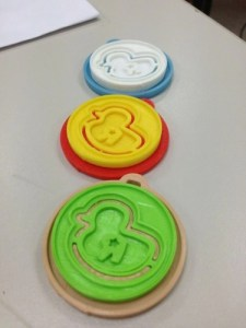 Duck coins with the snap-on necklace adaptor [courtesy of the Fung Group]