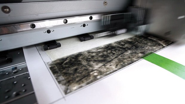 """This triple-thick handmade print is being printed on a 64"""" Roland printer that has been modified to accept the paper and 12 of Cone's custom inks."""